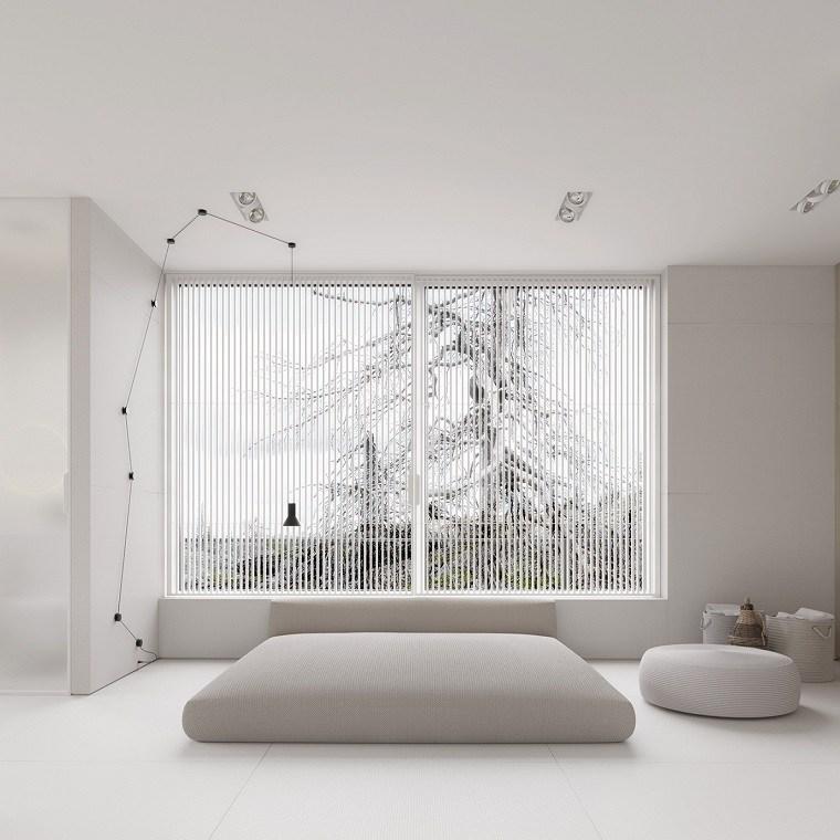 dormitorio con cama en suelo